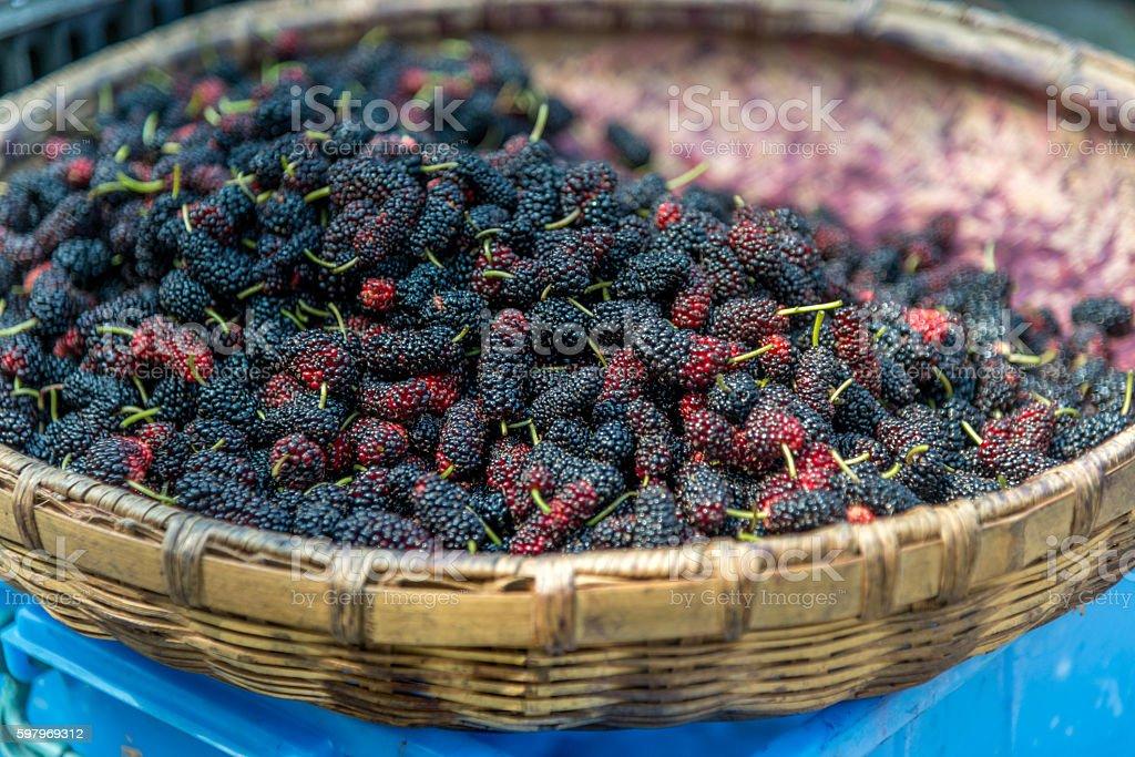 black mulberry fruit in basket, shot in China - foto de acervo
