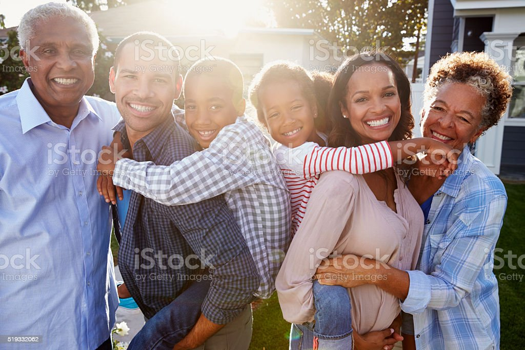 Black multi generation family outside, backlit portrait stock photo