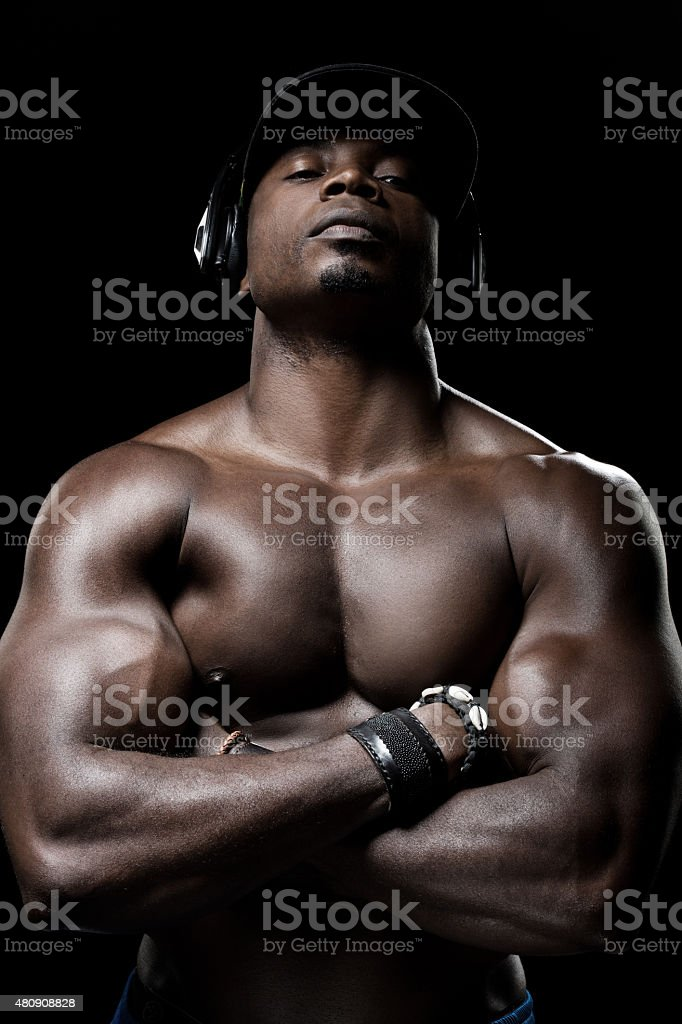 black muscled man listening to music stock photo