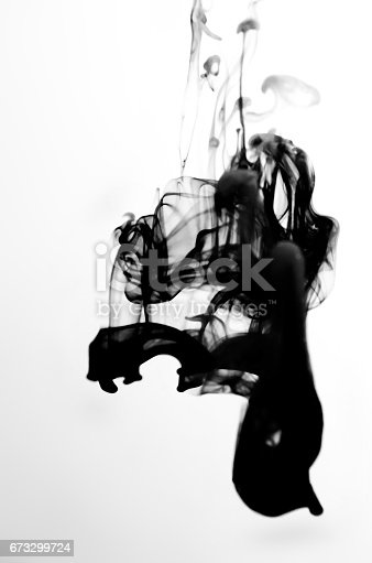 istock Black аnd gray ink dropped into water on white background 673299724