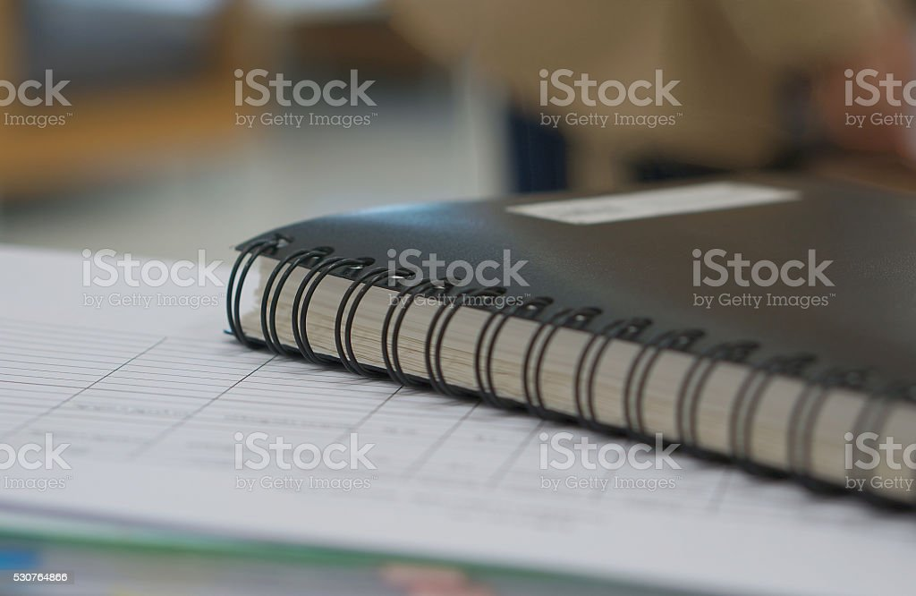Black Notebook And Document In Office Stock Photo - Download Image