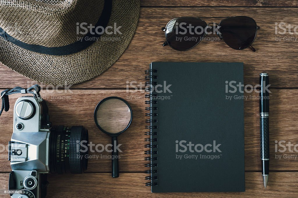 Black notebook with copyspace and retro camera stock photo