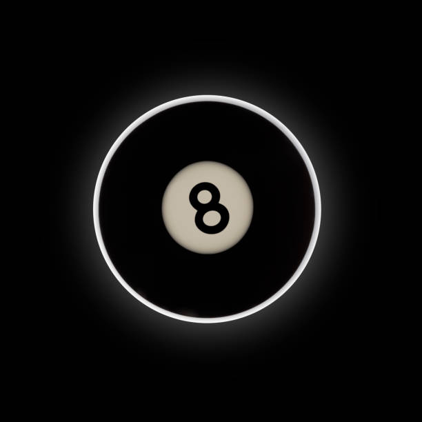 Black number 8 pool ball on a black background stock photo