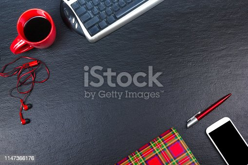 615494694 istock photo Black Office desk table with computer, pen and a cup of coffee, lot of things. Top view with copy space. 1147366176