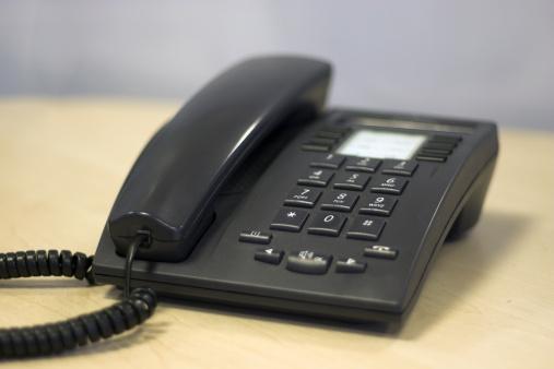 A Modern Sleek Office phone in Black