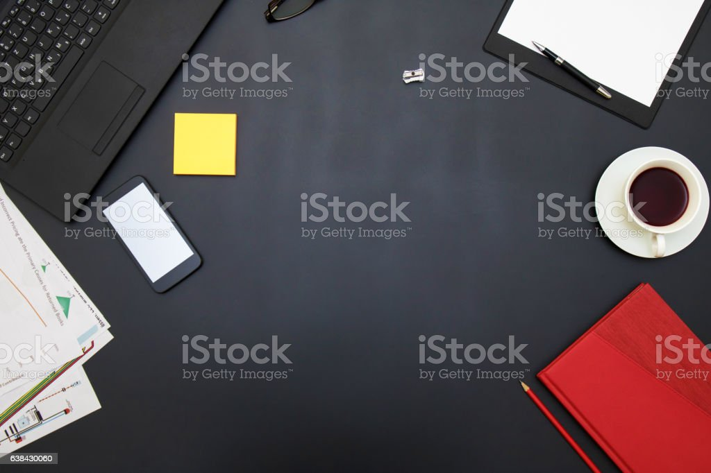 Black office table with supplies. Top view with copy space stock photo
