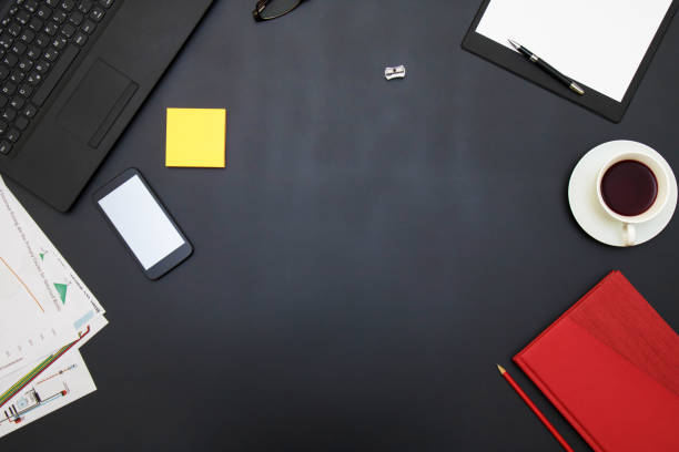 black office table with supplies. top view with copy space - einfache holzprojekte stock-fotos und bilder