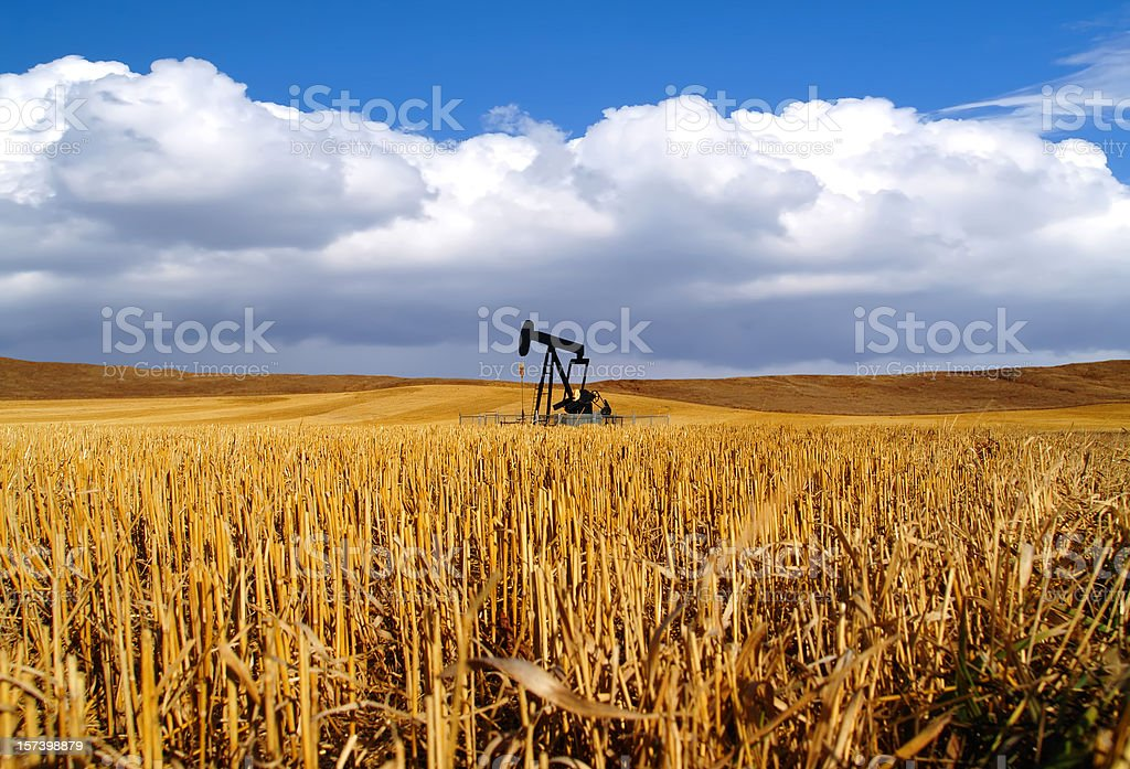 Black Oil Pumpjack in Field - Storm Approaching royalty-free stock photo