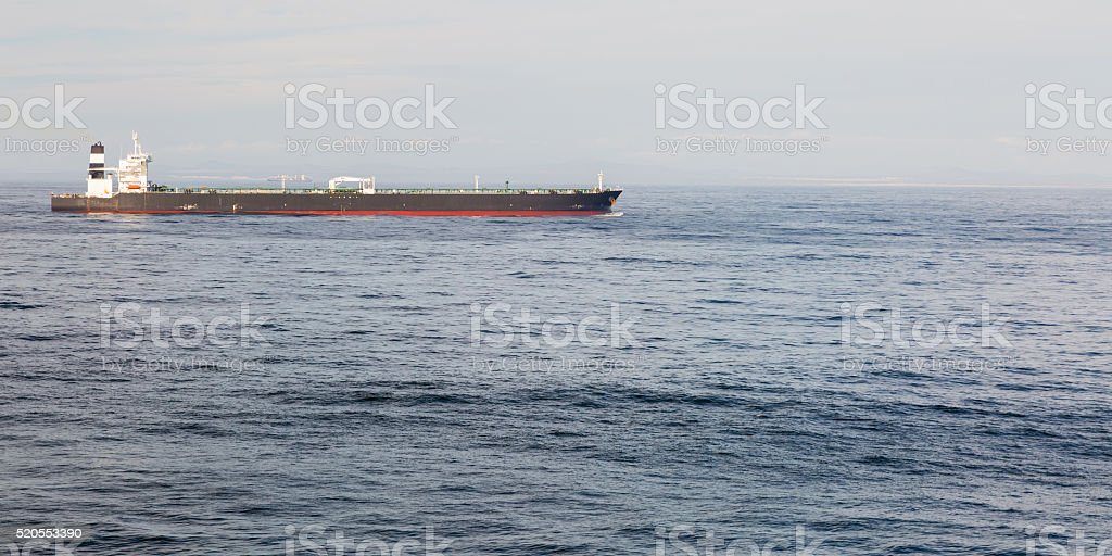 Long background image of a crude oil tanker in the blue ocean.