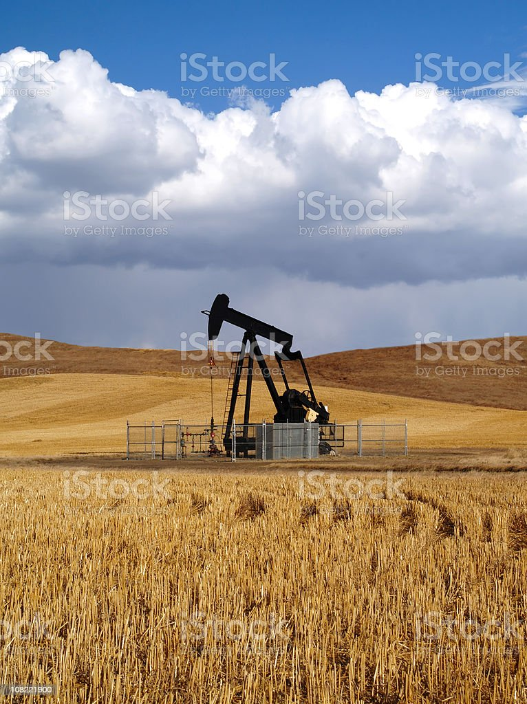 Black Oil Well Pumpjack With Storm Approaching royalty-free stock photo