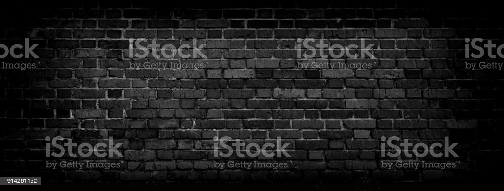 Black Old Brick wall panoramic background in high resolution stock photo