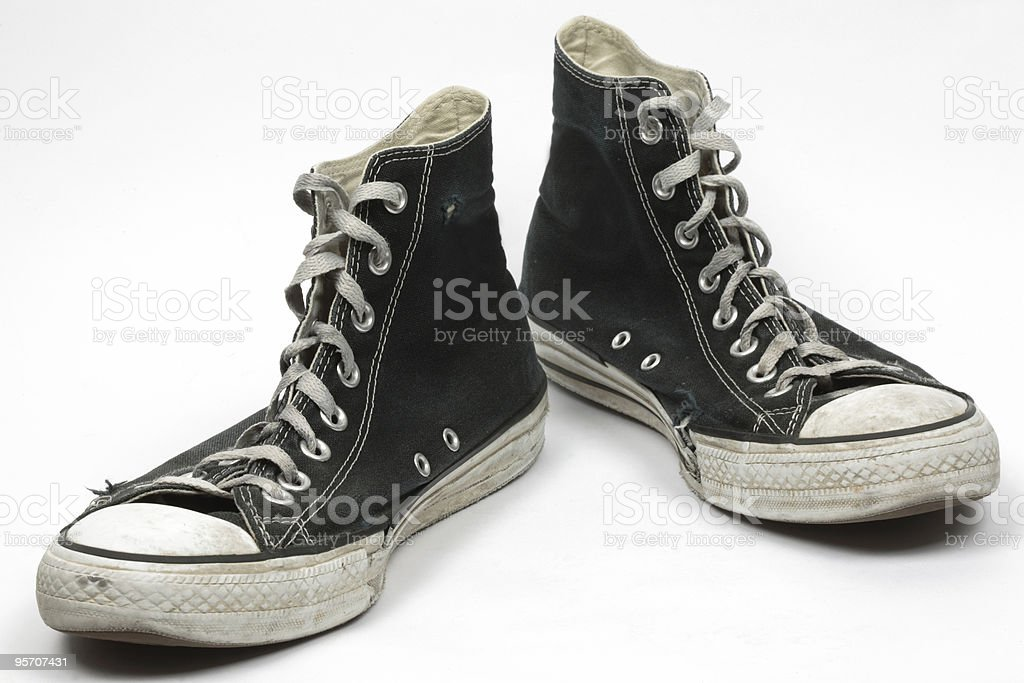 Black old canvas sneakers, isolated stock photo