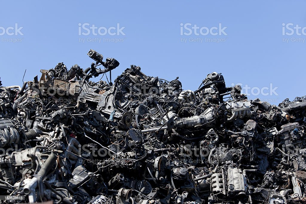 Black old greasy car parts on junkyard royalty-free stock photo