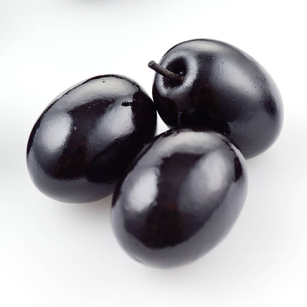 Black olive isolated on white​​​ foto