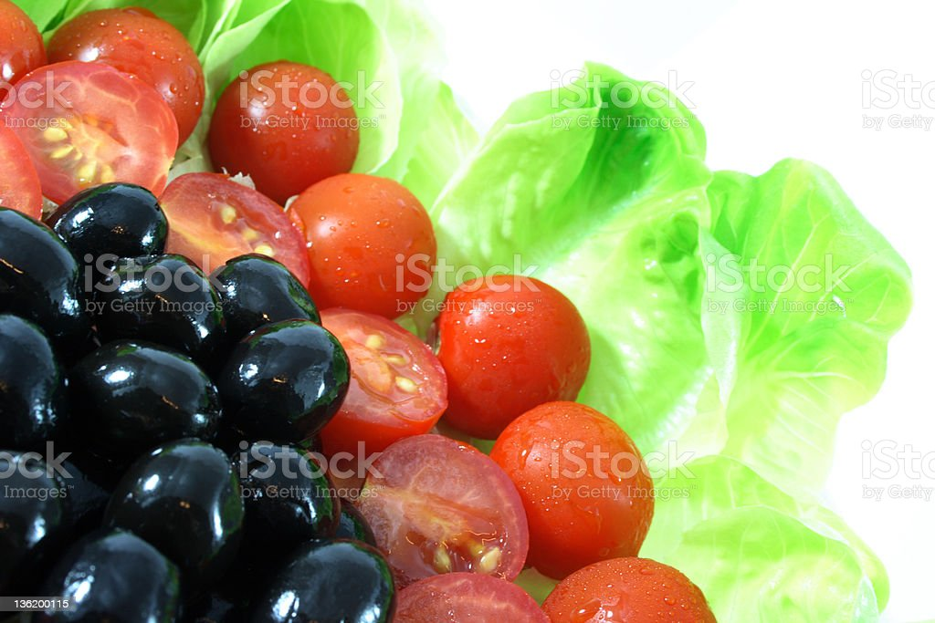 Black Olive, Tomato, lettuce. Diet time - healthy vegetable royalty-free stock photo