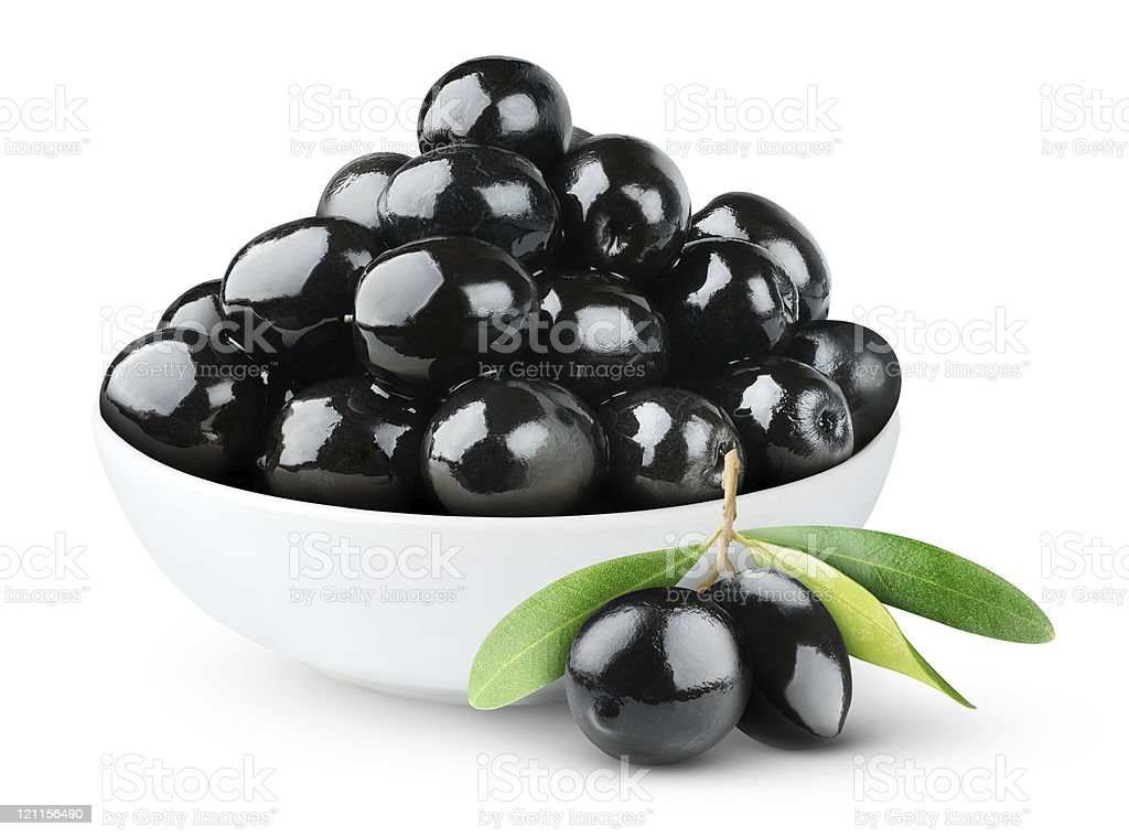 Black olives in a bowl on white background stock photo