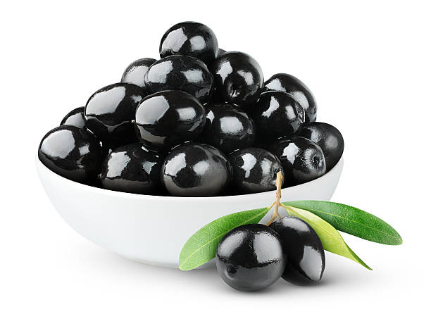 Black olives in a bowl on white background​​​ foto