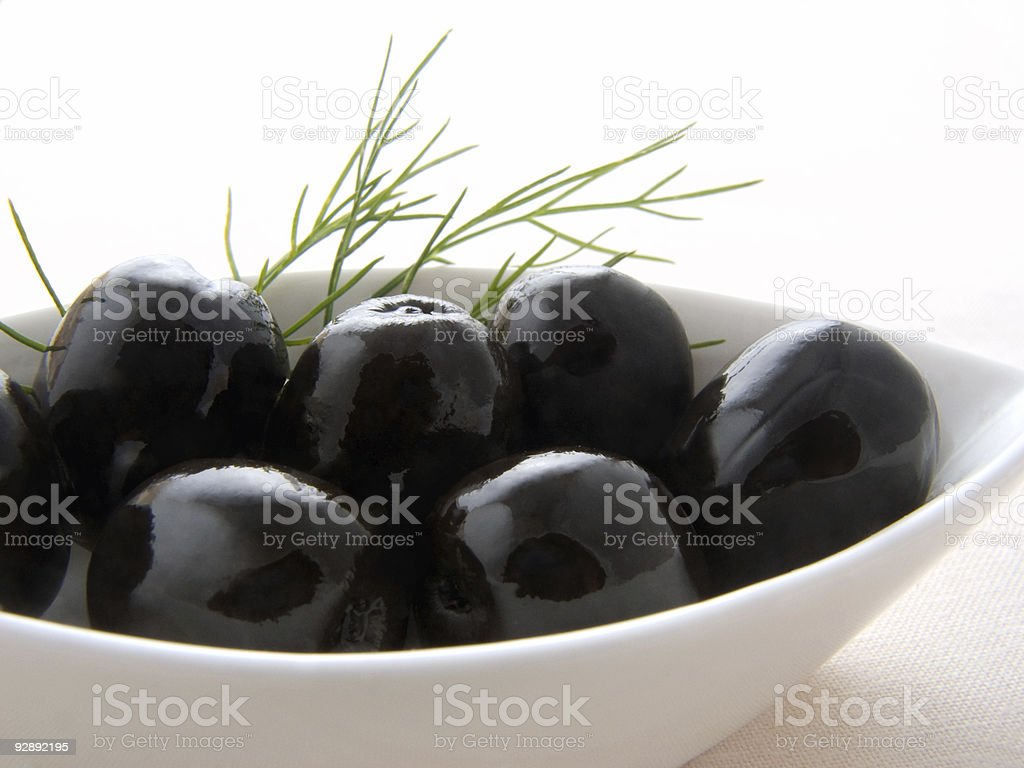 Black olives in the white bowl stock photo