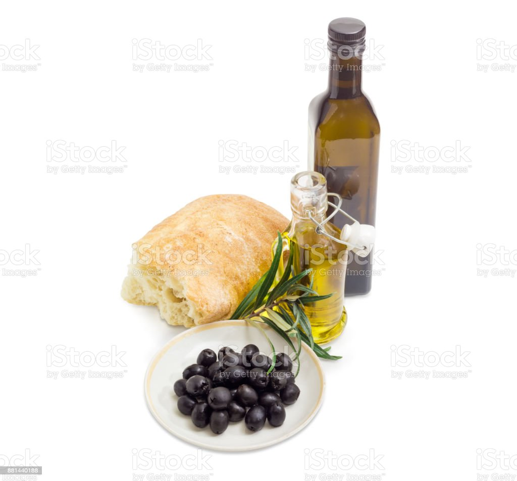 Black olives, olive oil, olive branch and ciabatta stock photo