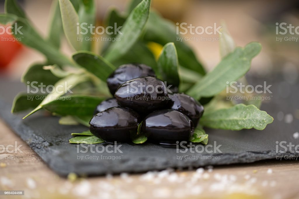black olives on natural olive tree leaves zbiór zdjęć royalty-free
