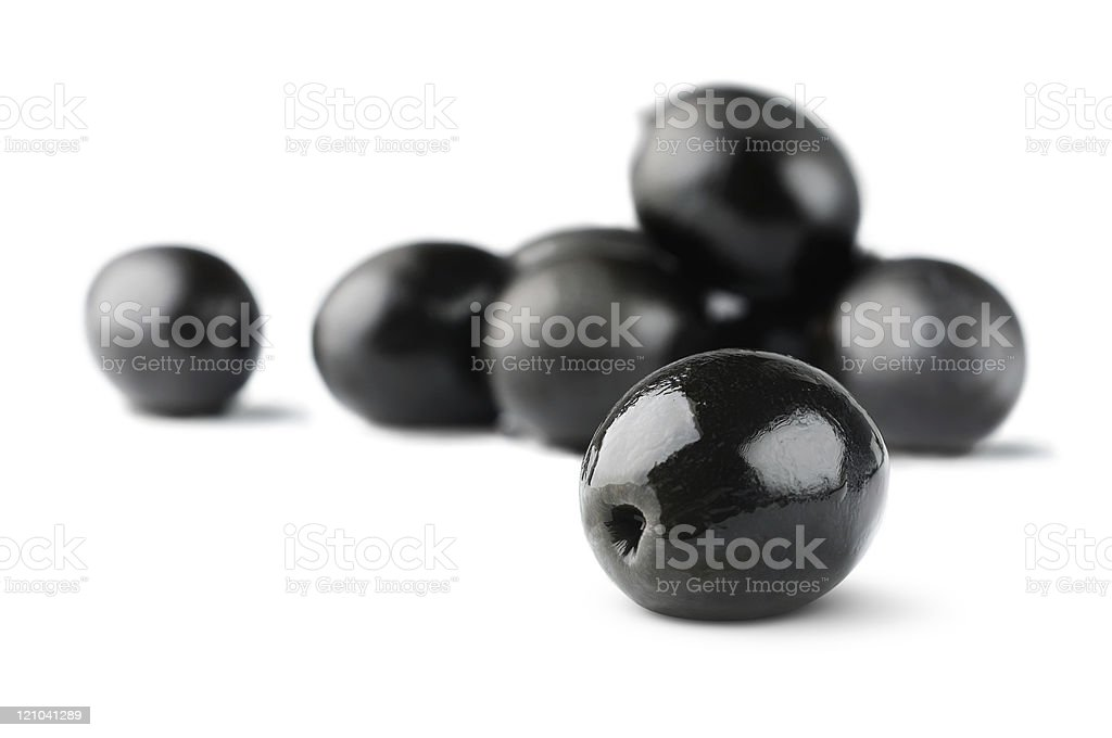 Black olives on white background, selective focus stock photo