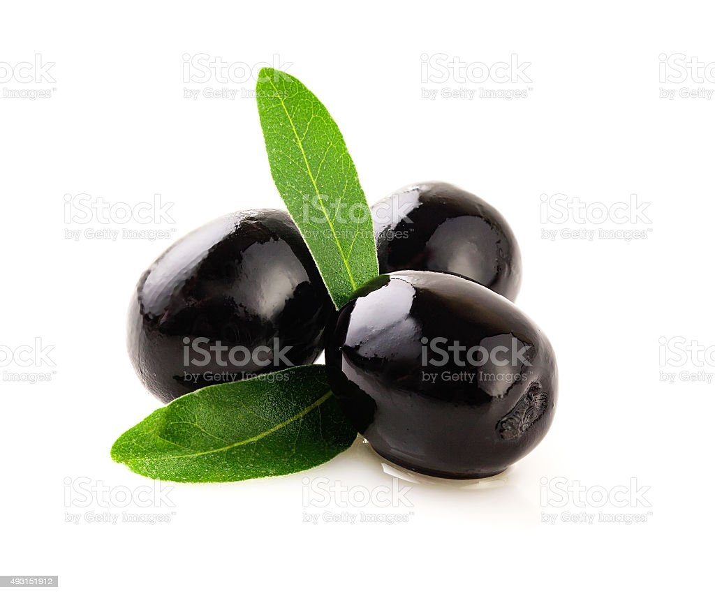 Black olives on white . stock photo