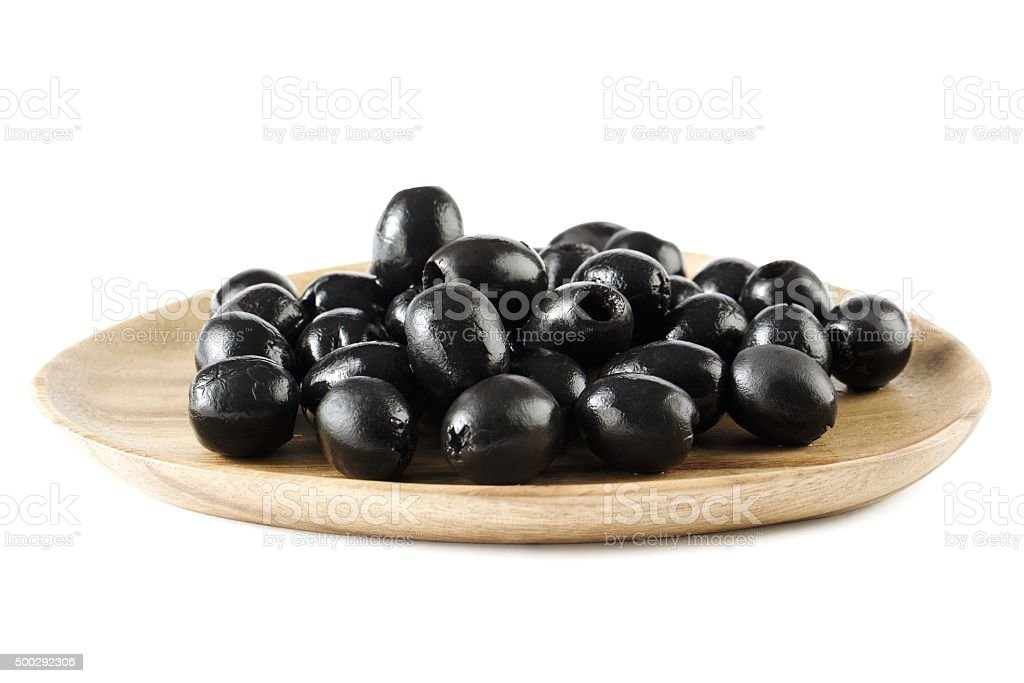 black olives on wooden plate stock photo