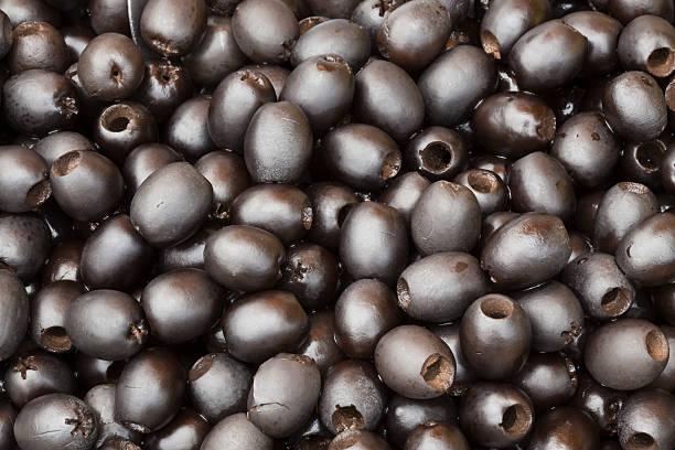 schwarze oliven struktur - schwarze olive stock-fotos und bilder