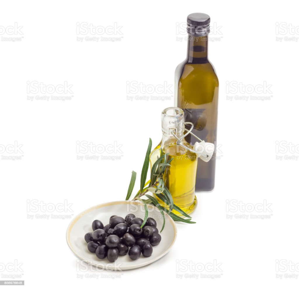 Black olives, two bottles of olive oil and olive branch stock photo