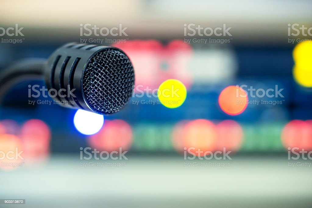 Black operator microphone on the control panel on the television stock photo