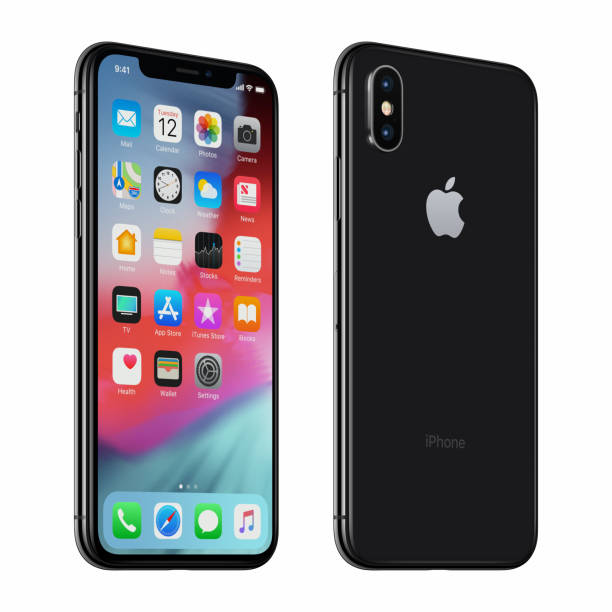 Black or Space Gray rotated Apple iPhone X with iOS 12 on the screen stock photo