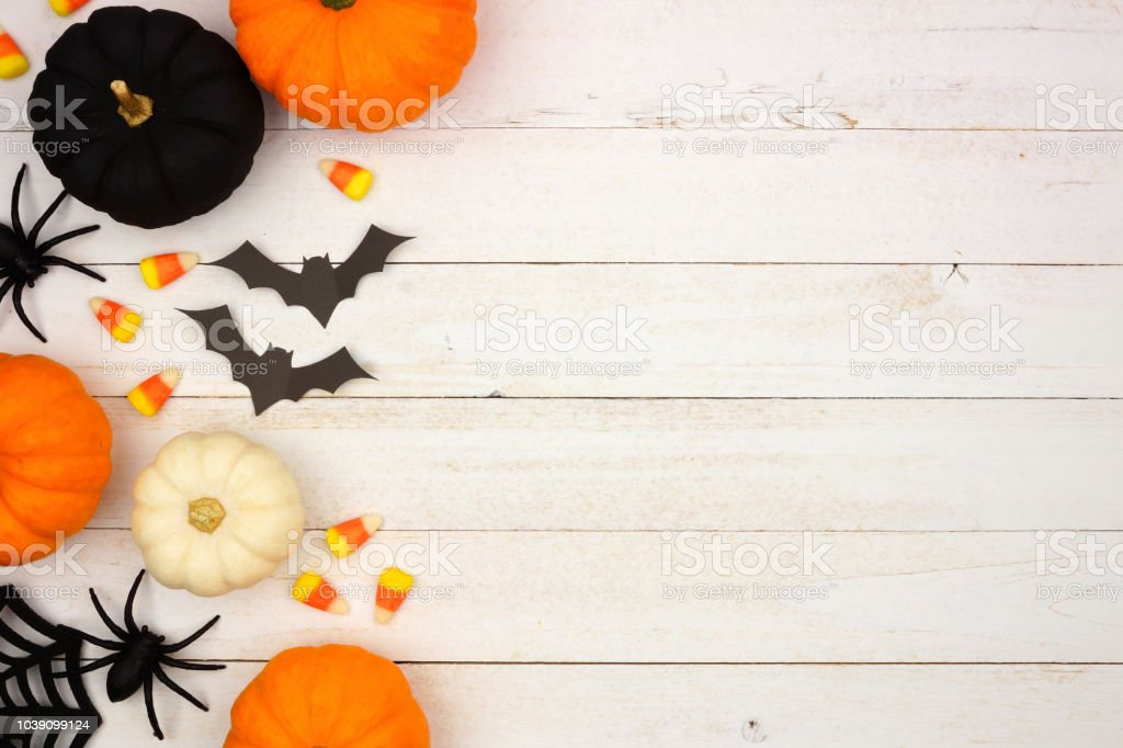 Black, orange and white Halloween side border over white wood royalty-free stock photo