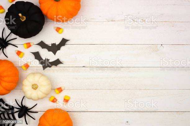 Black orange and white halloween side border over white wood picture id1039099124?b=1&k=6&m=1039099124&s=612x612&h=vsvr1p pkupdzqou7xfjc3t8t2zwdbuvlqdpgr2bygg=