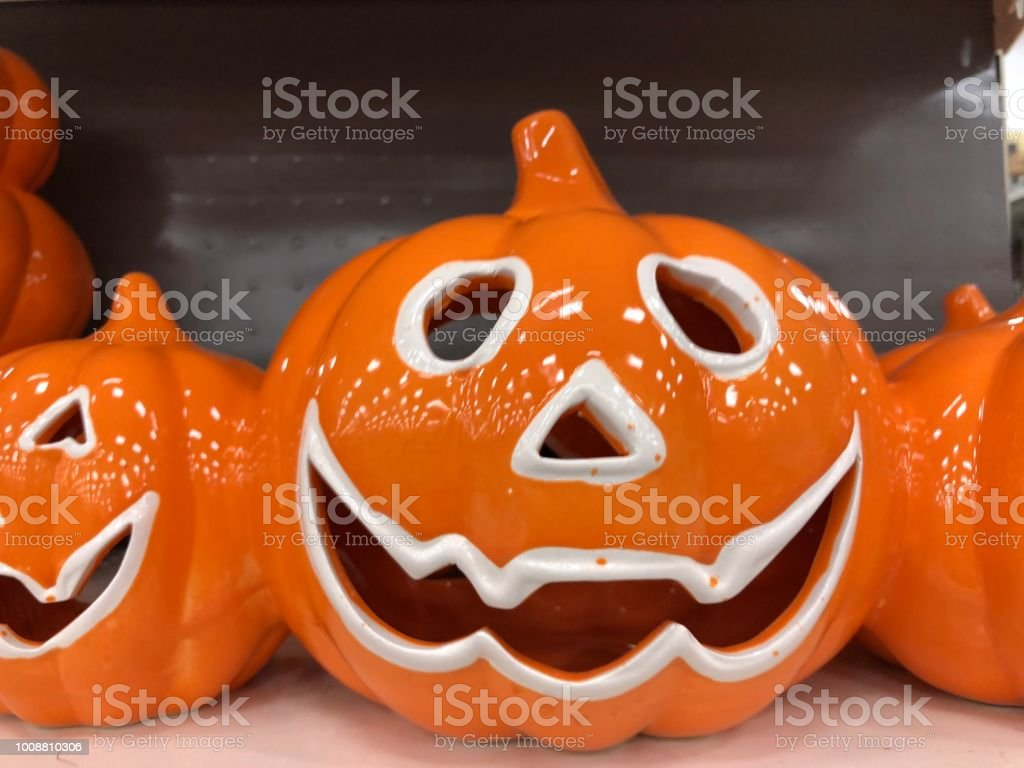 Black orange pumpkin store shelf