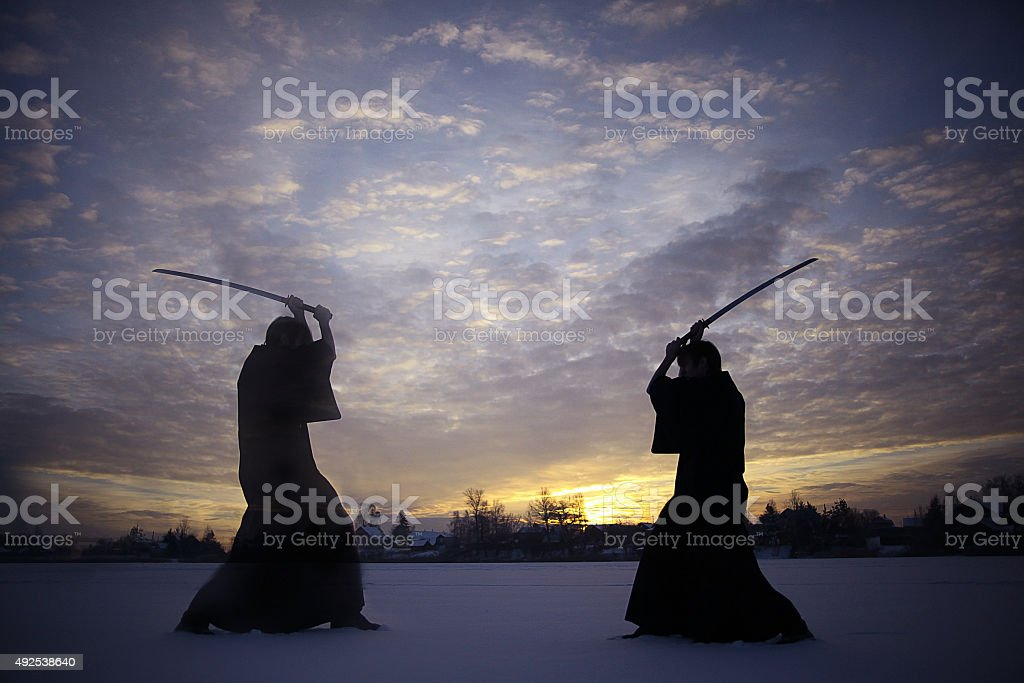 Black oriental martial arts warrior winter training stock photo