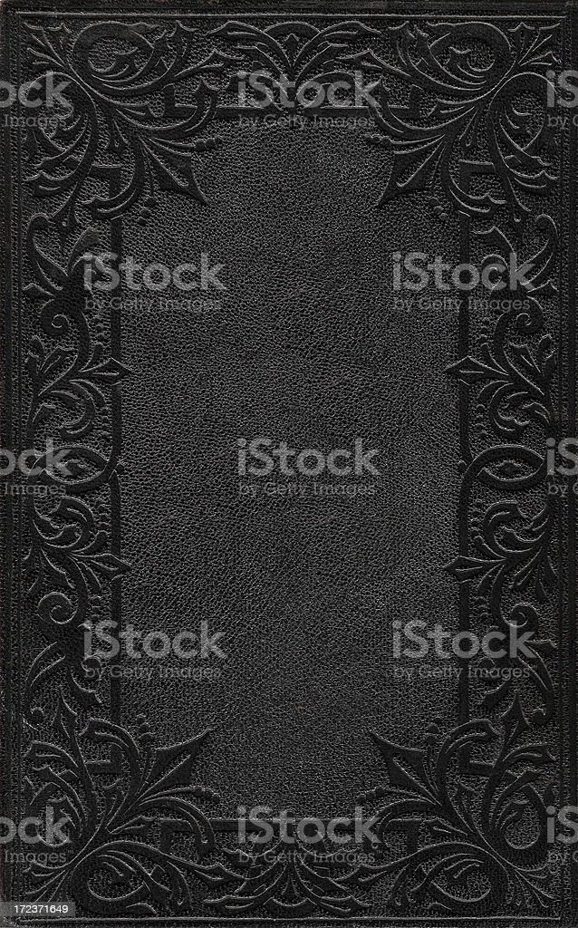 A black ornately embossed book cover stock photo