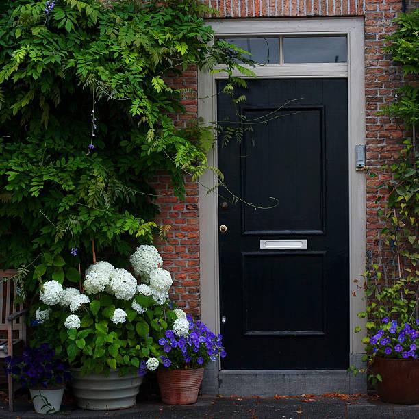 Black outside house door ,brick wall stock photo
