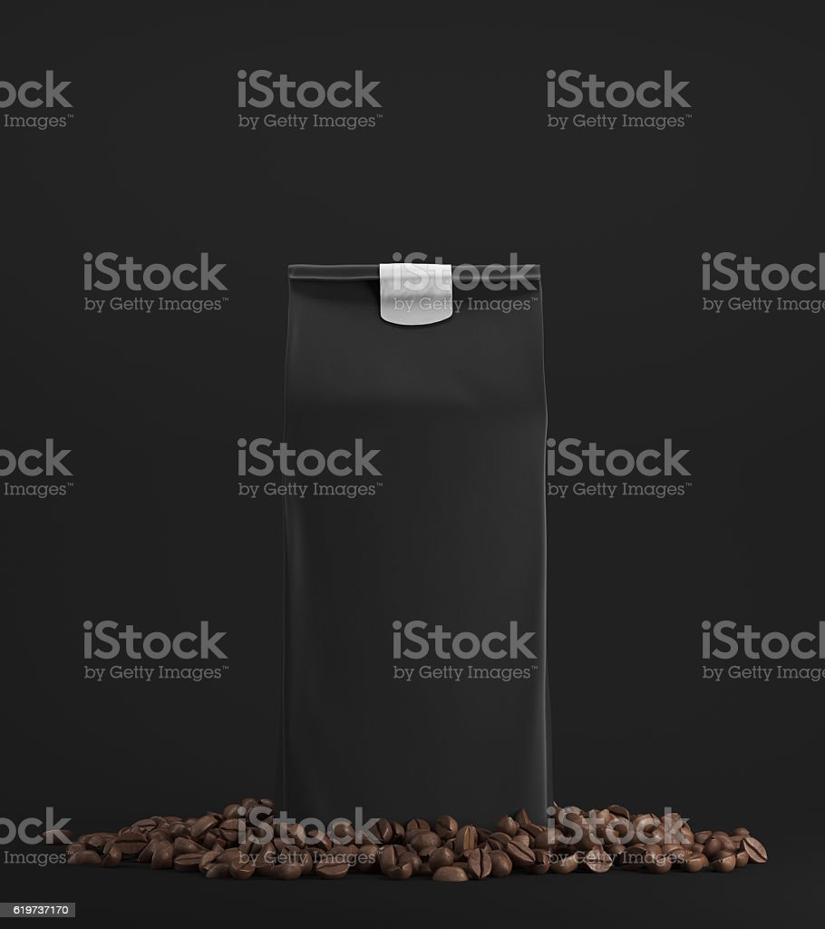 Black pack of coffee against black background stock photo