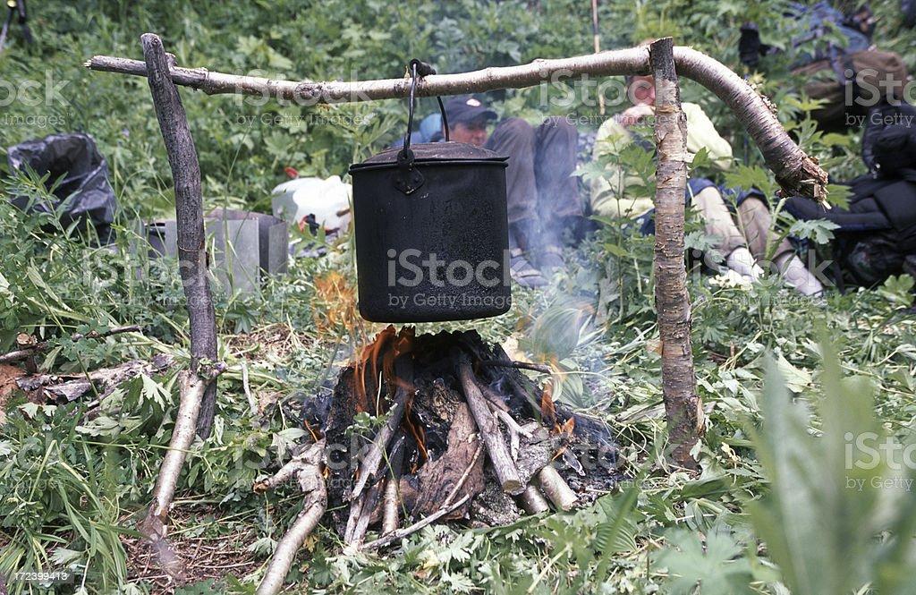 Black pan above campfire royalty-free stock photo
