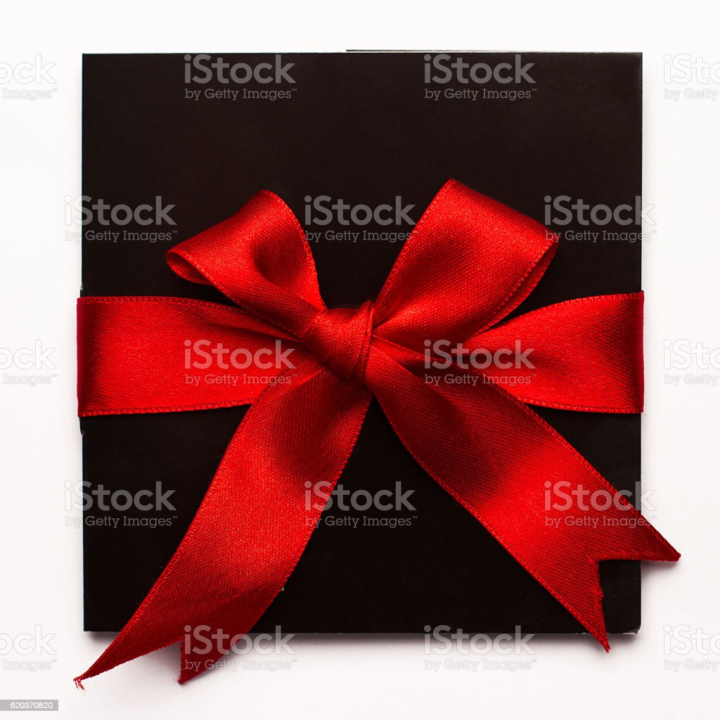 Black paper card with red textile ribbon isolated on white foto de stock royalty-free