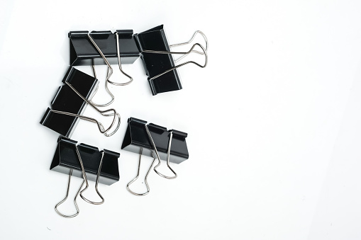 Black Paper Clips On White Stock Photo - Download Image Now