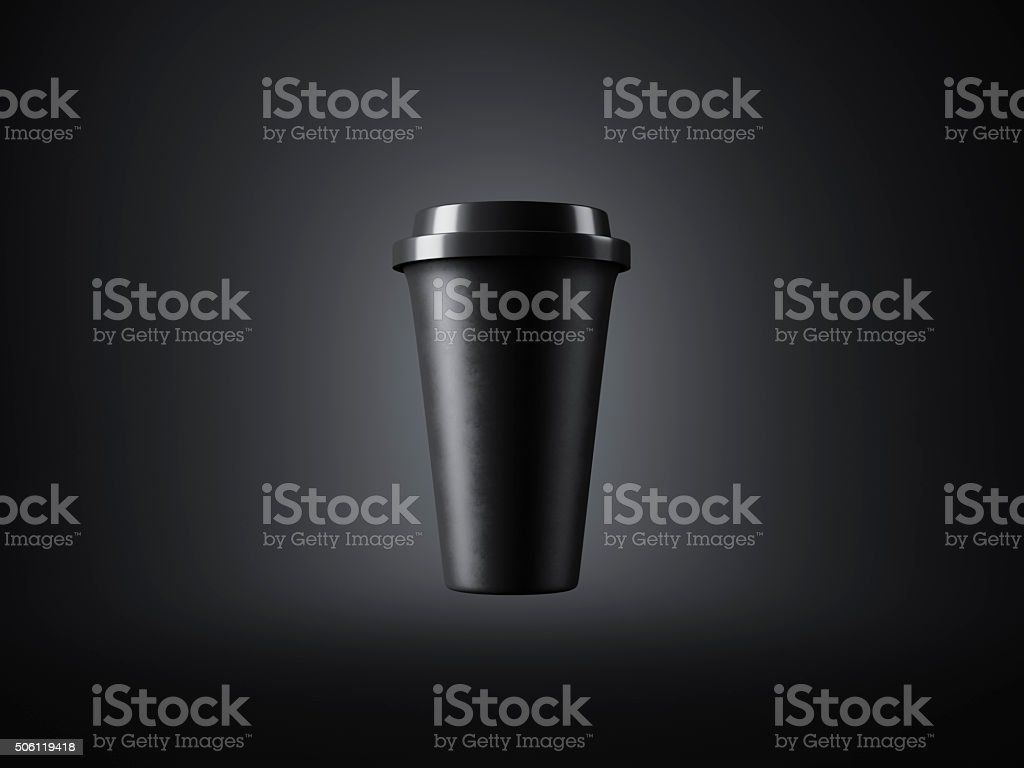 Black paper cup with plastic top on the dark background stock photo