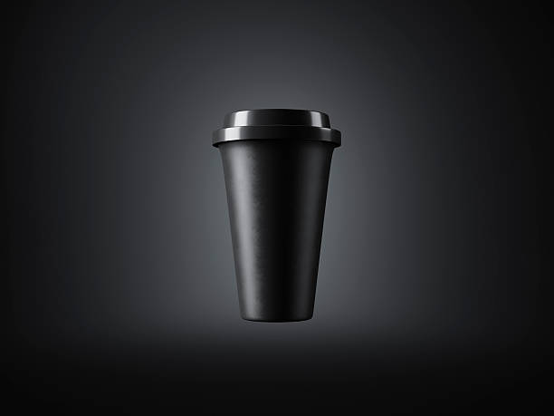 Black paper cup with plastic top on the dark background Black and blank coffee cup on the dark background. Horizontal black coffee stock pictures, royalty-free photos & images