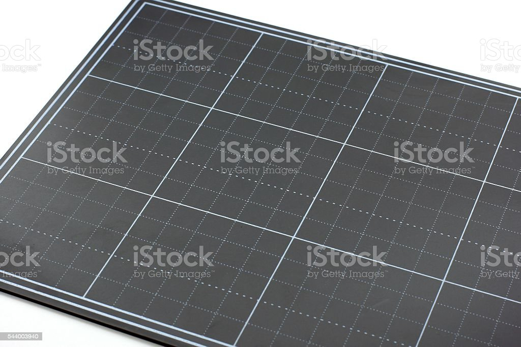 Black paper cutting mat stock photo