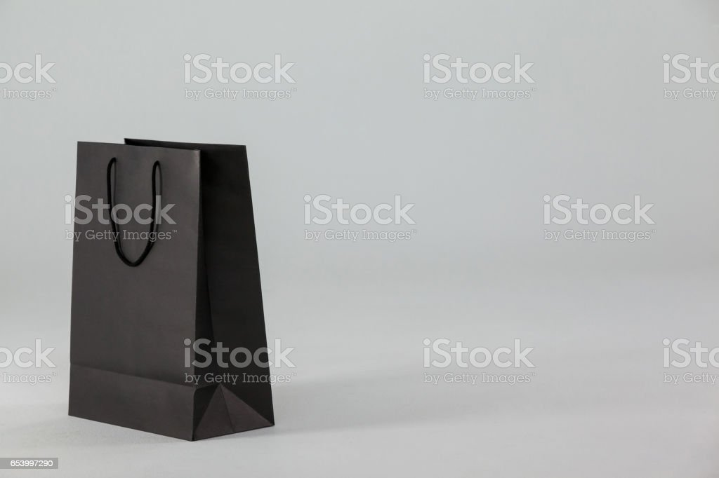 Black paper shopping bag stock photo