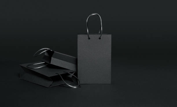 Black paper shopping bags on black background Black Friday, Shopping Bag, Black background, retail, luxury, masculinity, copy space black friday stock pictures, royalty-free photos & images