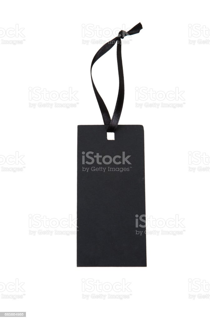 Black paper tag with a ribbon stock photo