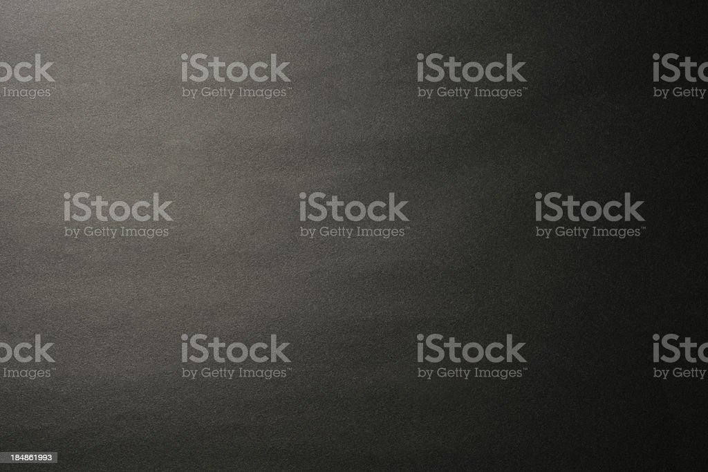 Black paper texture background with spotlight royalty-free stock photo