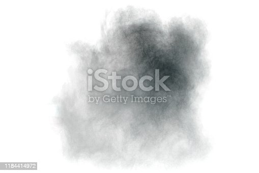 istock Black particles splatter on white background. Black powder dust burst. 1184414972