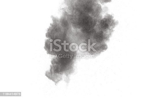 istock Black particles splatter on white background. Black powder dust burst. 1184414973
